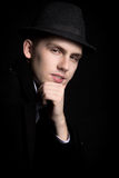Portrait of smiling young man in hat and coat Royalty Free Stock Image