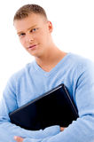 Portrait of smiling young man holding laptop Royalty Free Stock Photo