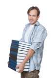 The portrait of smiling young man holding stack of books Stock Photography