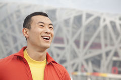 Portrait of smiling young man in park, Beijing, close-up Stock Photos