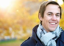 Portrait of a smiling young man standing outdoors Stock Photo