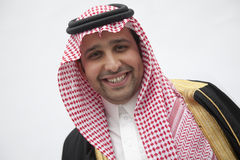 Portrait of smiling young man in traditional Arab clothing and Kaffiyeh, studio shot Stock Images