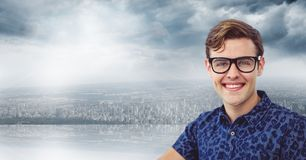 Portrait of smiling young man wearing glasses against cloudy sky Royalty Free Stock Photography