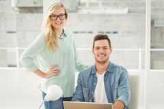 Portrait of smiling young man and woman with laptop Stock Photo