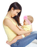 Portrait of smiling young mother and baby playing Royalty Free Stock Image