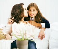 Portrait of smiling young mother and daughter at home, happy fam Stock Photography