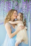 Portrait of smiling young mother holds her little daughter on a hands Stock Photo
