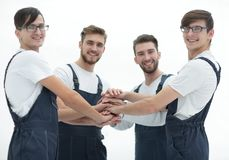 Team of movers joining hands. Stock Image