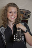 Portrait of smiling young musician with guitar Stock Photography