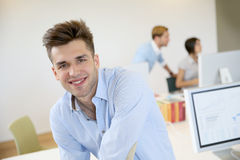 Portrait of smiling young office worker Stock Photos