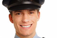 Portrait of smiling young policeman close up. Stock Photography