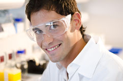 Portrait of a smiling young researcher. Inside his laboratory Royalty Free Stock Images