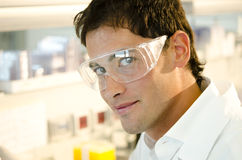 Portrait of a smiling young researcher. Inside his laboratory Stock Photography