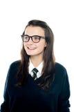 Portrait of smiling young schoolgirl looking away Stock Photography