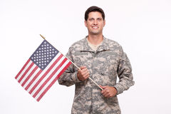 Portrait of a smiling young soldier with American flag. Smiling young soldier with American flag Royalty Free Stock Photo