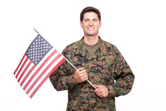 Portrait of a smiling young soldier with American flag. Smiling soldier with American flag royalty free stock photo