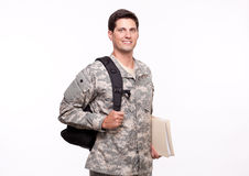 Portrait of a smiling young soldier with backpack and documents Royalty Free Stock Photo
