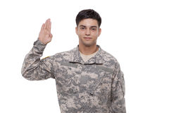 Portrait of a smiling young soldier performing oath. Soldier performing a military oath Royalty Free Stock Photo