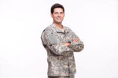 Portrait of a smiling young soldier posing with arms crossed. Young soldier with arms crossed Stock Photography