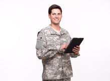 Portrait of a smiling young soldier using a digital tablet Royalty Free Stock Images