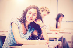 Portrait of smiling young student posing. In classroom Stock Photo