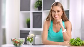 Portrait of smiling young vegan girl posing at white room enjoying healthy lifestyle