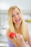 Portrait of smiling young woman with apple Stock Image