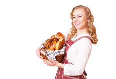 Portrait of a smiling young woman with a basket of pastries in her hands stock photography