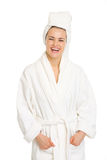 Portrait of smiling young woman in bathrobe Stock Photography