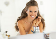 Portrait of smiling young woman in bathroom Stock Images