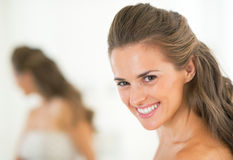 Portrait of smiling young woman in bathroom Royalty Free Stock Photo