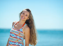 Portrait of smiling young woman on beach Stock Photos