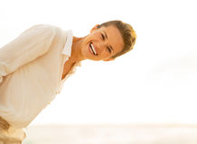 Portrait of smiling young woman on the beach Stock Photography