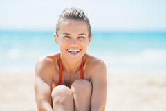 Portrait of smiling young woman on beach Royalty Free Stock Photo