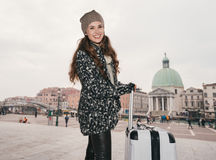 Portrait of smiling young woman with big luggage bag in Venice Royalty Free Stock Photos