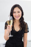 Portrait of a smiling young woman with champagne Stock Image