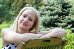 Portrait of smiling young woman closeup outdoors. Royalty Free Stock Images