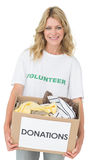 Portrait of a smiling young woman with clothes donation Stock Photography