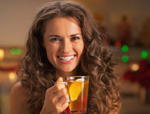 Portrait of smiling young woman with cup of ginger tea Royalty Free Stock Image