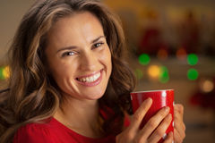 Portrait of smiling young woman with cup of hot chocolate Royalty Free Stock Images