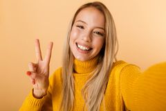 Portrait of a smiling young woman dressed in sweater royalty free stock photography