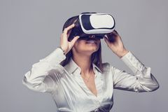 Woman in White Shirt using vr glasses Royalty Free Stock Image