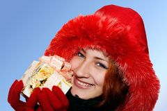 Portrait of a smiling young woman giving a gift Royalty Free Stock Photo