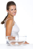 Portrait of smiling young woman with glass bowl with water Royalty Free Stock Photography