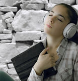 Portrait of a smiling young woman with headphone Stock Photography