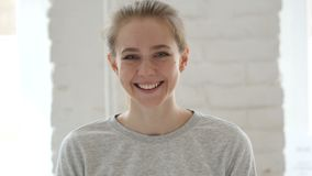Portrait of smiling young woman stock video