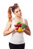 Portrait of smiling young woman holding fresh spring vegetables. stock images