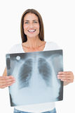 Portrait of a smiling young woman holding lung xray Royalty Free Stock Image