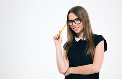 Portrait of a smiling young woman holding pencil Stock Photos