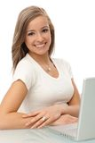 Portrait of smiling young woman with laptop Royalty Free Stock Photography